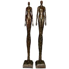 Tall Bronze Man and Woman Sculptures by Tom Corbin