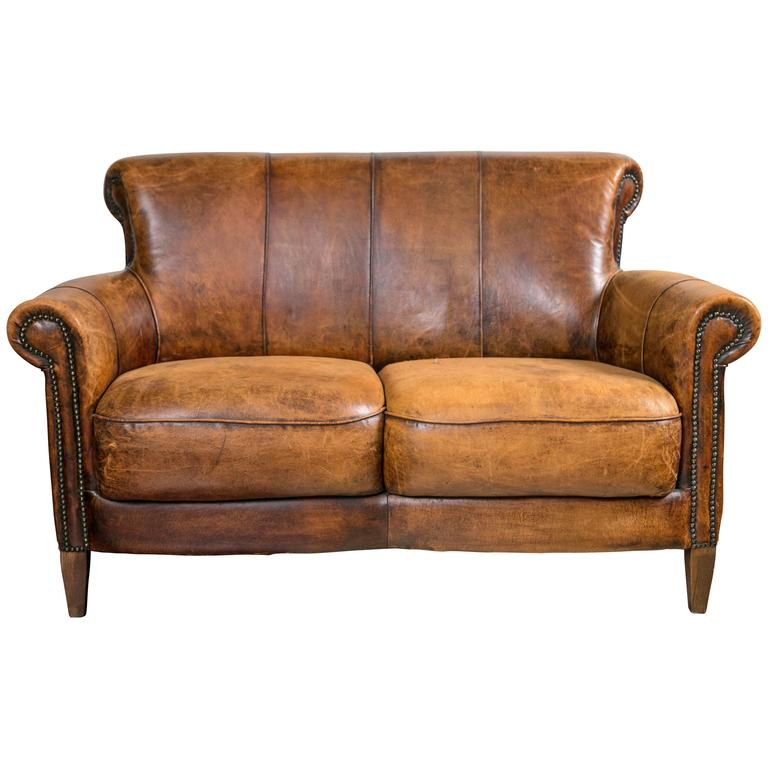 Vintage French Distressed Art Deco Leather Sofa For