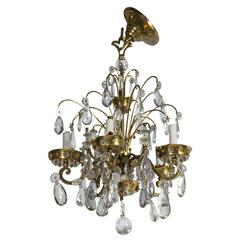 A Fine Bronze And Crystal French Art Deco Chandelier by Maison Jansen Five Arm