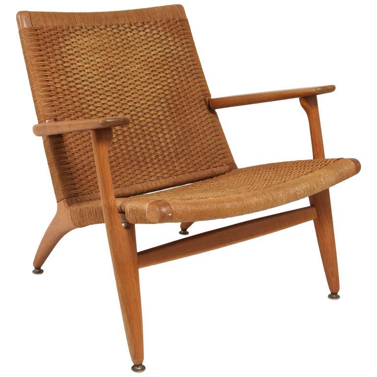 Hans Wegner Wicker Lounge Chair at 1stdibs