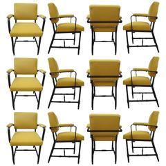 Twelve Armchairs by Jacques Adnet