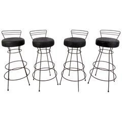 Four Mid-Century Iron and Vinyl Swivel Stools