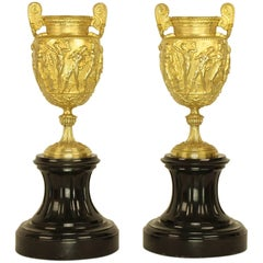 Pair of French Charles X Neoclassical Bacchanal Gilt Bronze Black Marble Urns