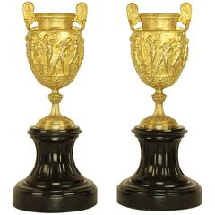 Pair of Charles X Gilt Bronze Urns on a Black Marble socle