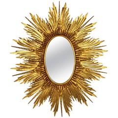 Large Spanish Carved Giltwood Sunburst or Starburst Oval Mirror