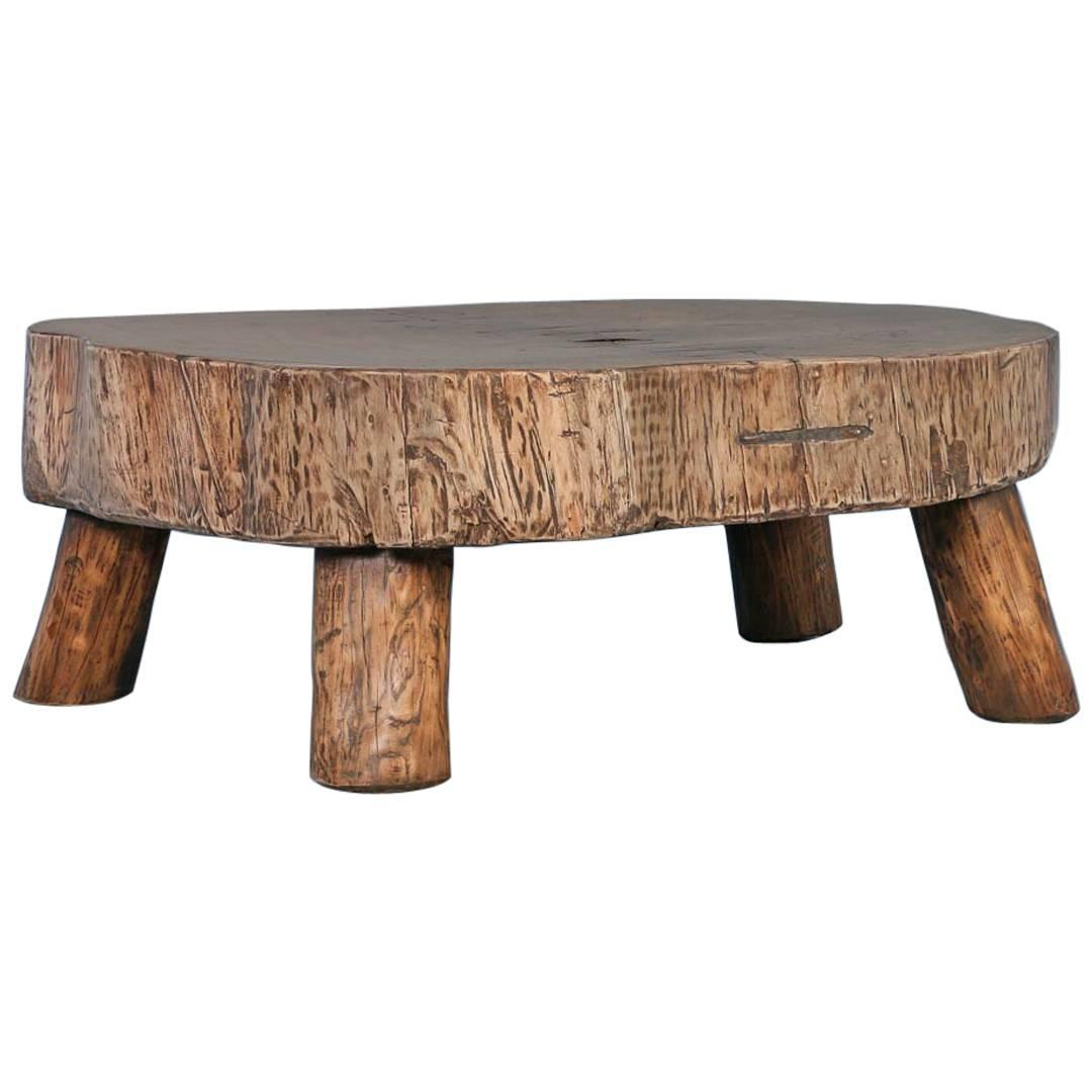 Rustic antique coffee table made from large slab of wood for Wood slab coffee table