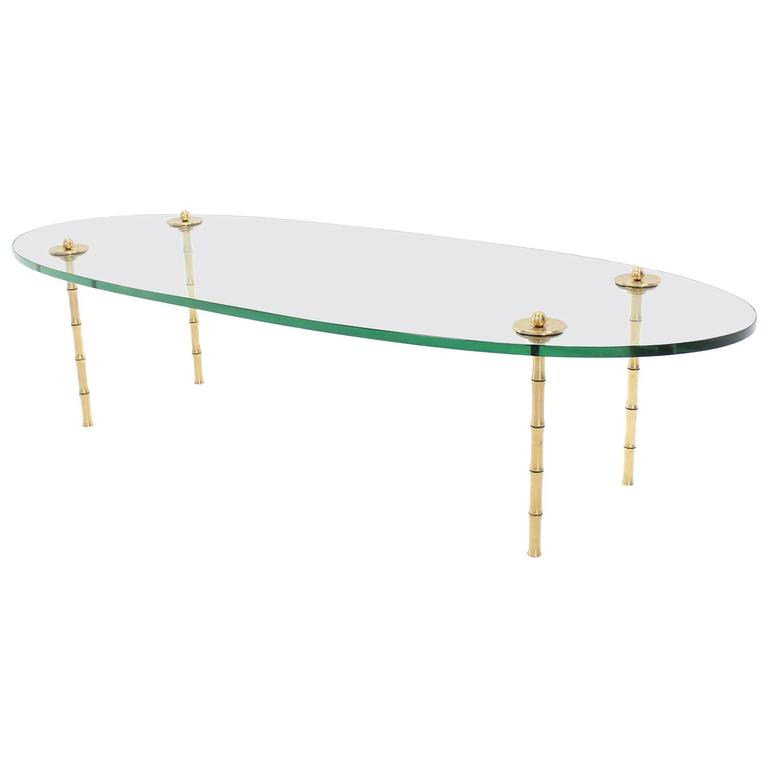 Turned Brass Faux Bamboo Legs Thick Glass Top Oval Coffee Table For Sale