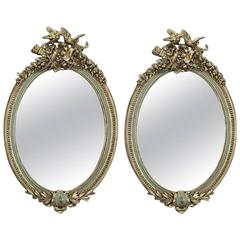 Pair of Early 20th Century French Louis XVI Carved Painted and Gilt Oval Mirrors