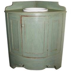 Corner Vanity with a Bowed Front