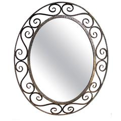 A French Art Deco Openwork Iron Oval Mirror in the Style of Edgar Brandt
