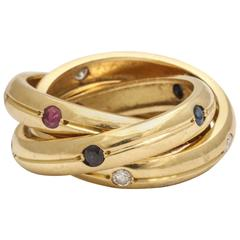 Vintage Cartier Ruby, Diamond and Sapphire Gold Trinity Ring