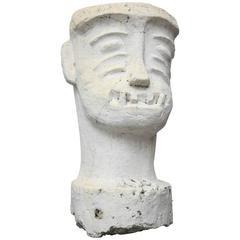 Group of Four Wacky Concrete Head Sculptures