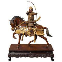 Antique Japanese Bronze of a Samurai on Horseback with a Bow and Arrow