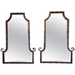 Pair of Smashing Faux Bamboo Gilt Metal and Ebonized Wood Mirrors