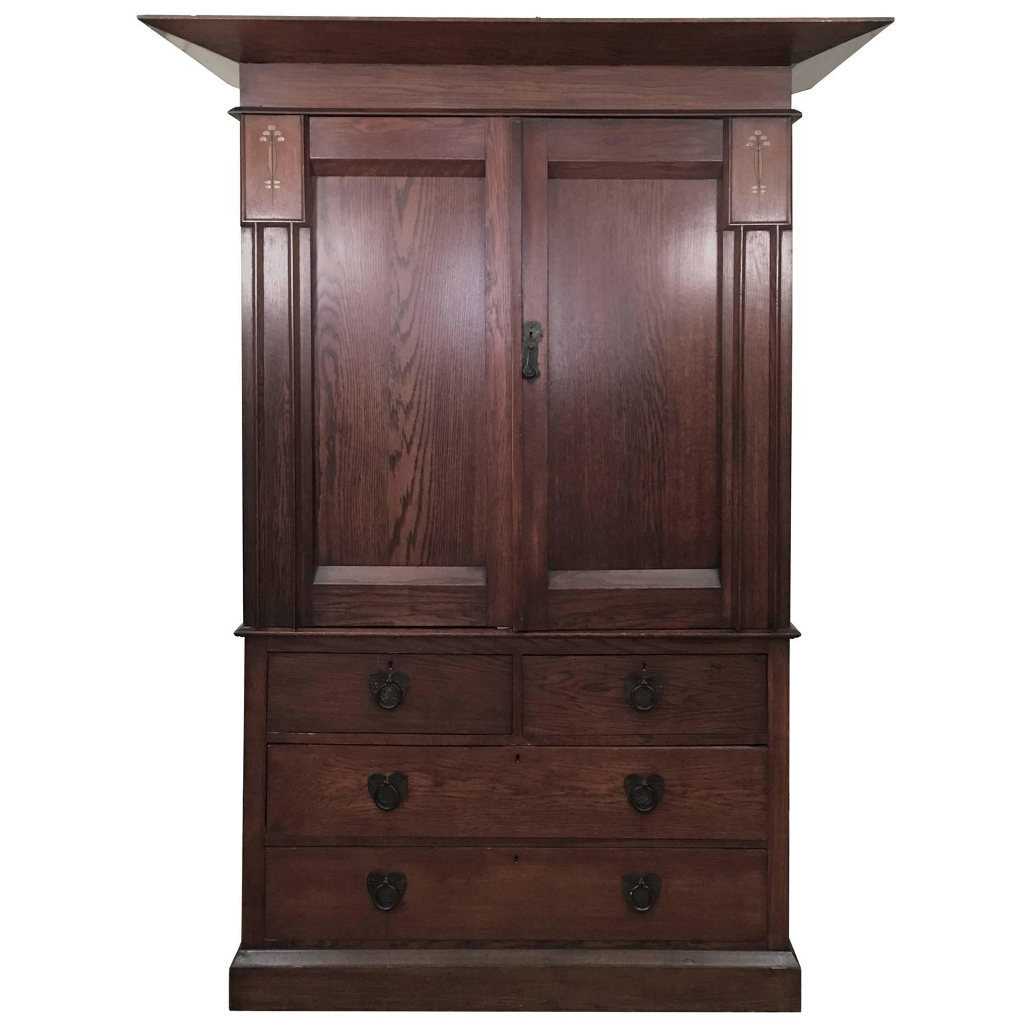 arts and crafts period architectural armoire for sale at