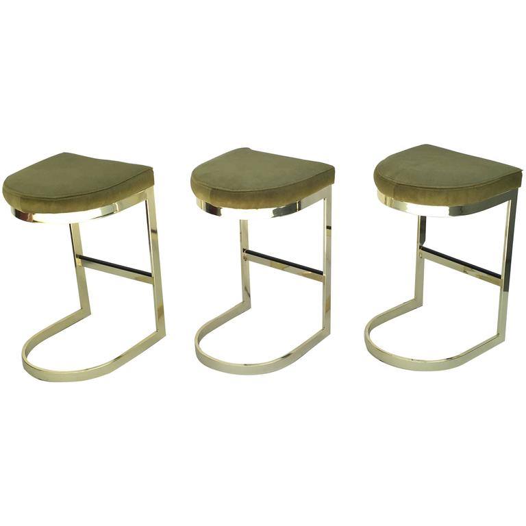 Set Of Three Polished Brass And Pony Hide Barstools By