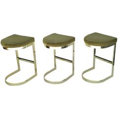 Set of Three Polished Brass and Pony Hide Barstools by Milo Baughman