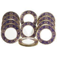 16 Royal Doulton Cobalt Blue Dinner Plates, Raised Paste Gold Rose Medallions