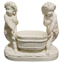 German Porcelain Figural Jardiniere Depicting Putti, 19th-20th Century