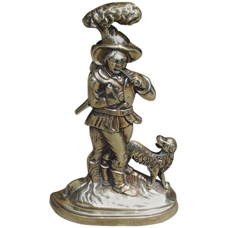 English cast brass woodsman and canine doorstop circa