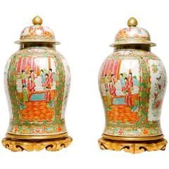 Pair of Chinese Rose Medallion Lidded Urns