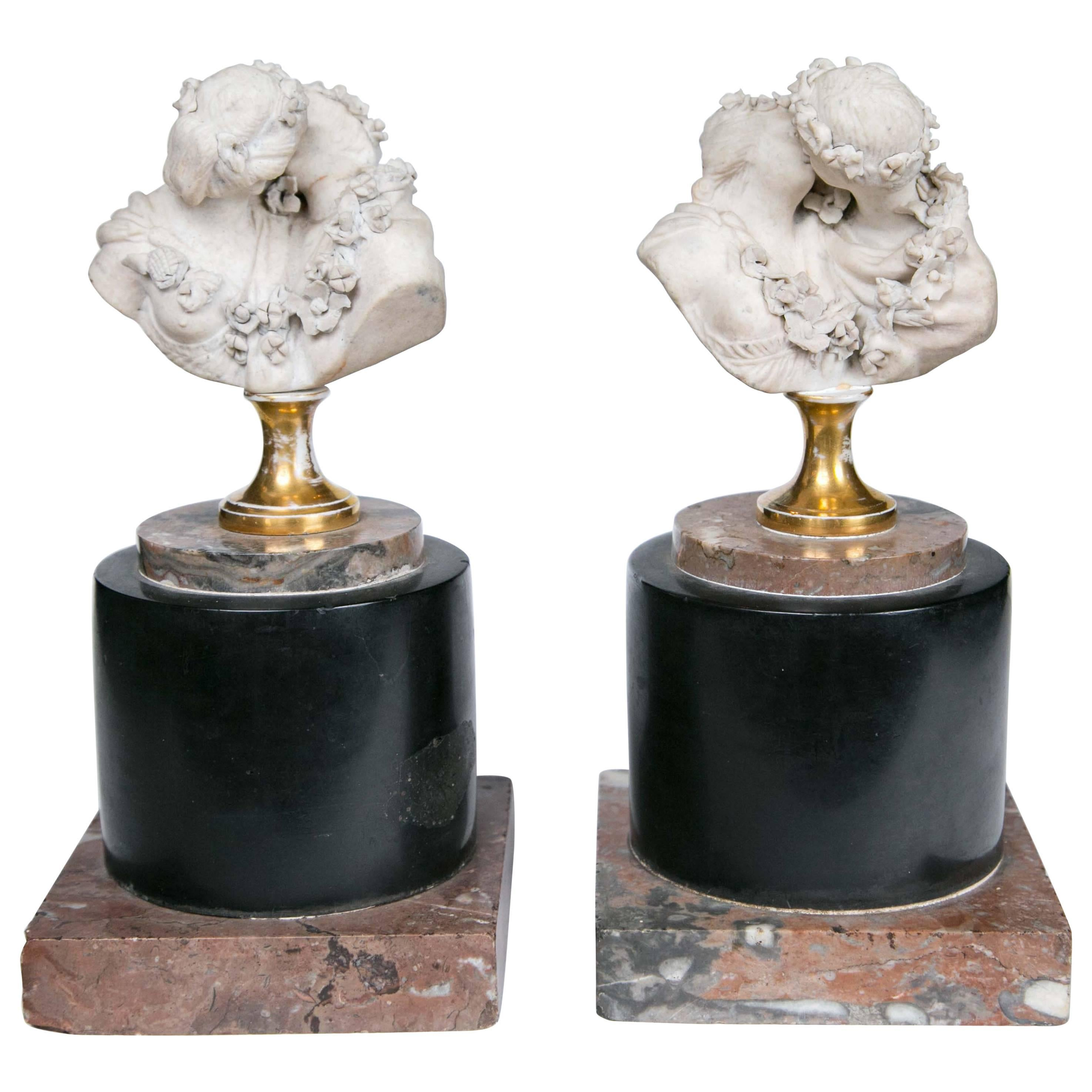 Pair of French Biscuit  Busts of Le Baiser Donne, after Houdon
