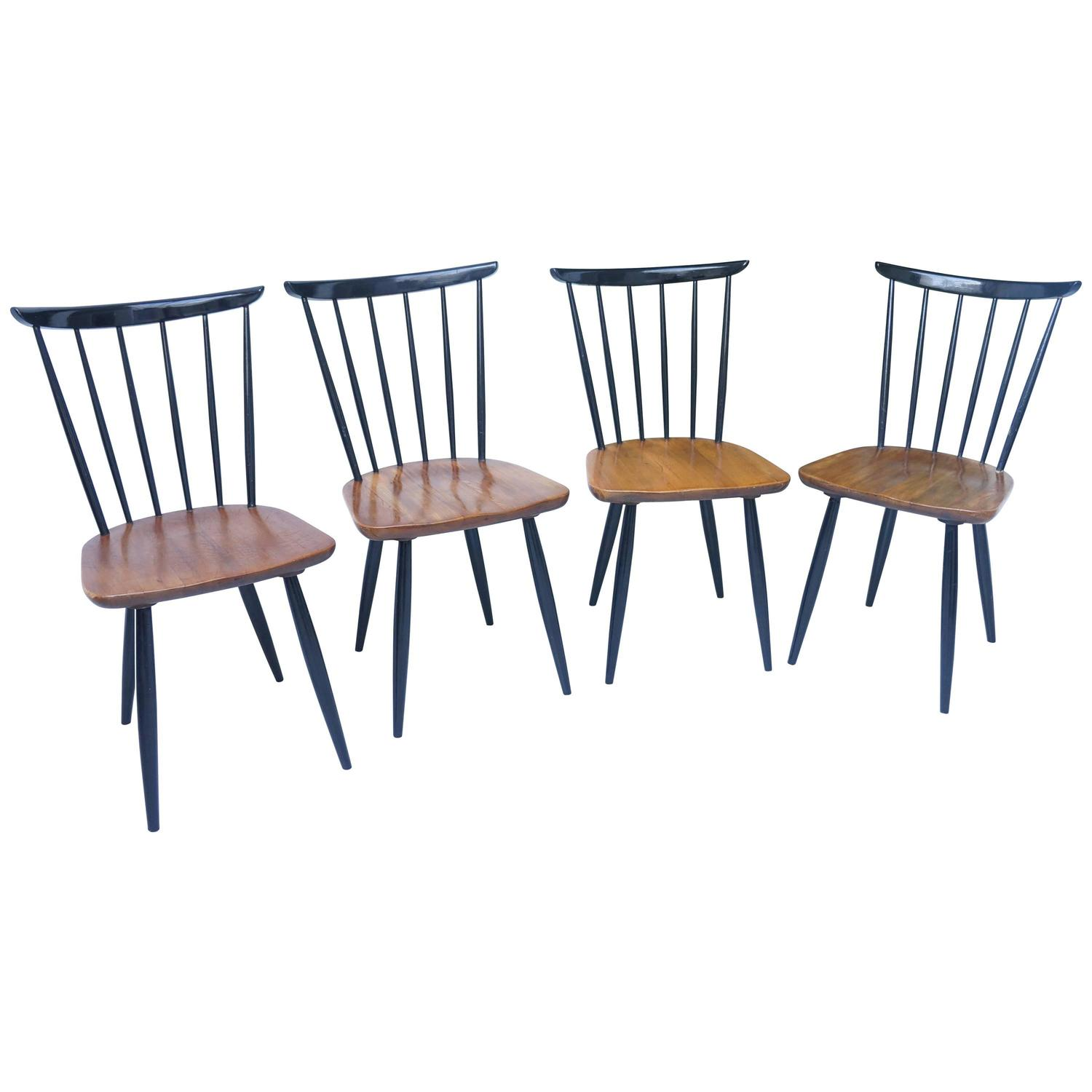Four mid century wooden spindle back chairs s in