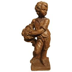 French Vintage Painted Cast Statue of a Boy Holding a Basket of Fruit