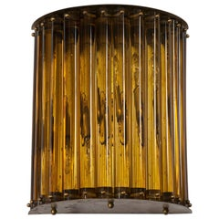 Single Wall Sconce in blown Murano Glass in amber color 1960s Italy