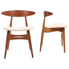 Set of Two Teak and Oak  CH33 Chairs by Hans J Wegner with Cream Leather