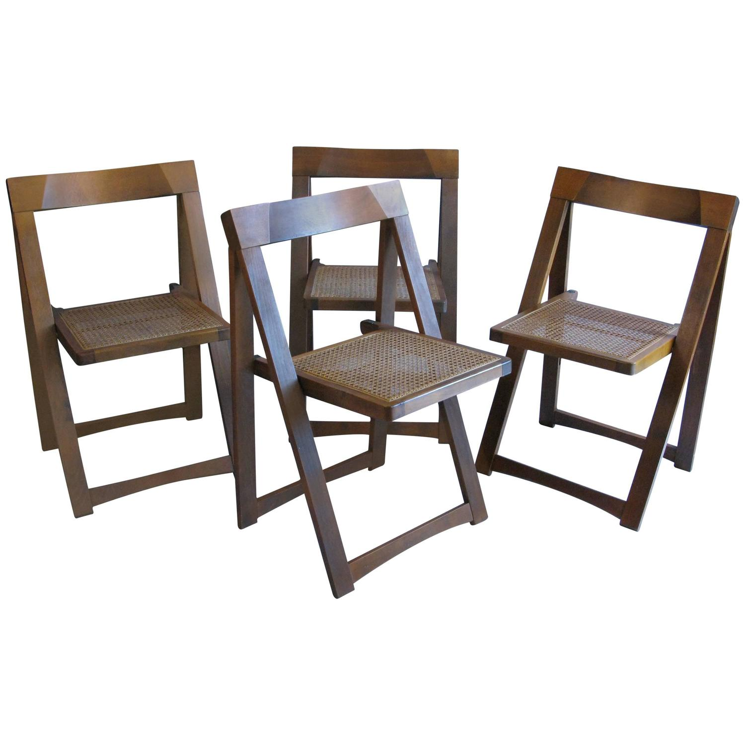 Set of Four Mid Century Walnut Folding Chairs with Caned Seats at 1stdibs
