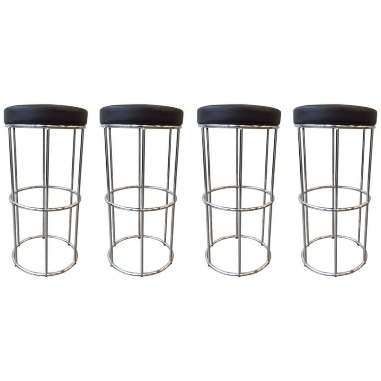 Four Vintage Tubular Chrome Bar Stools