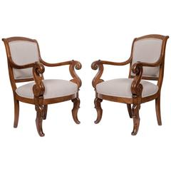 Pair of Solid Walnut French Restauration Armchairs