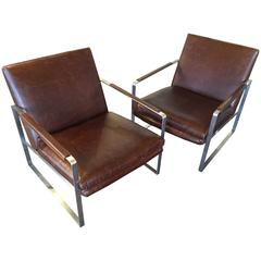 Brushes Steel and Distressed Leather Armchairs