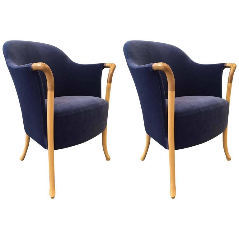 Pair of Giorgetti Progetti arm or lounge chairs. Chairs are upholstered in blue velvet with an oak and beech frame.