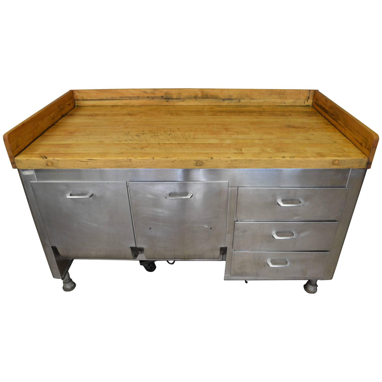 kitchen island with butcher block top and steel base