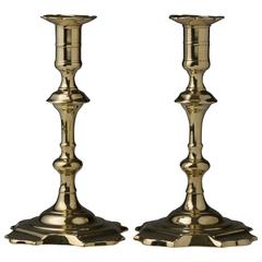 Pair of English Brass Petal and Dart Seamed Candlesticks, 18th Century