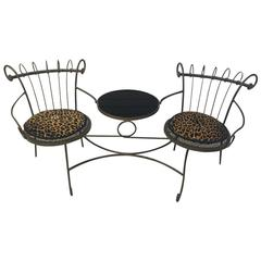 Tea Table with Two Chairs Having Leopard Print Cushions and Marble Top