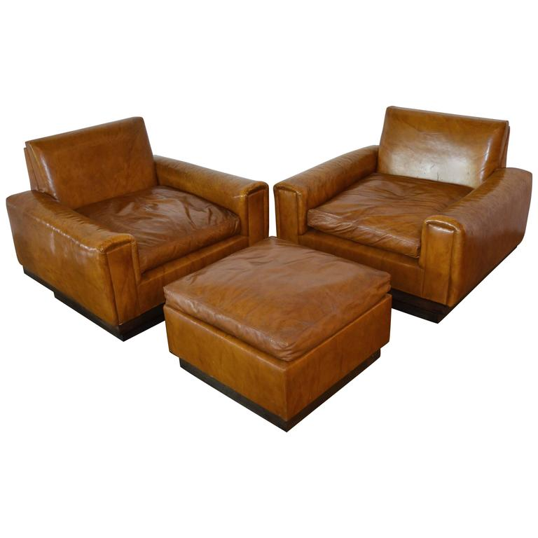 Merveilleux Mid Century French Cognac Leather Club Chairs And Ottoman