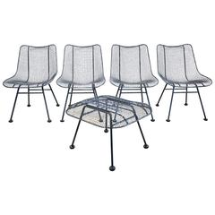 Set of Four Russell Woodard Sculptura Patio Chairs with Matching Ottoman