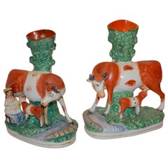 Pair of Staffordshire Figurines with Cows, Calves, and Spill Vases
