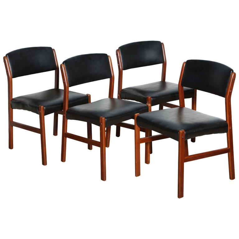 this 1960s set of four danish teak and black side chairs is no longer