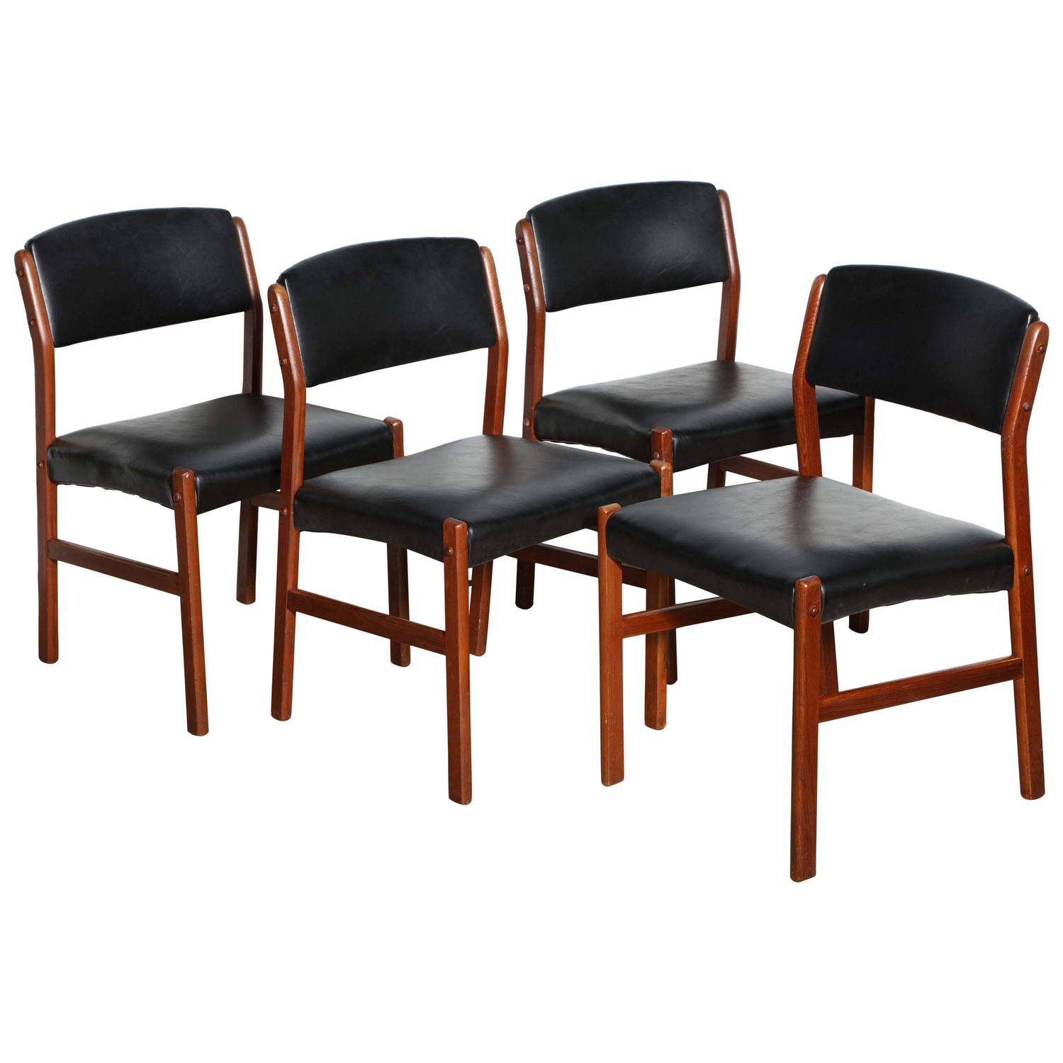 1960s set of four danish teak and black side chairs at 1stdibs