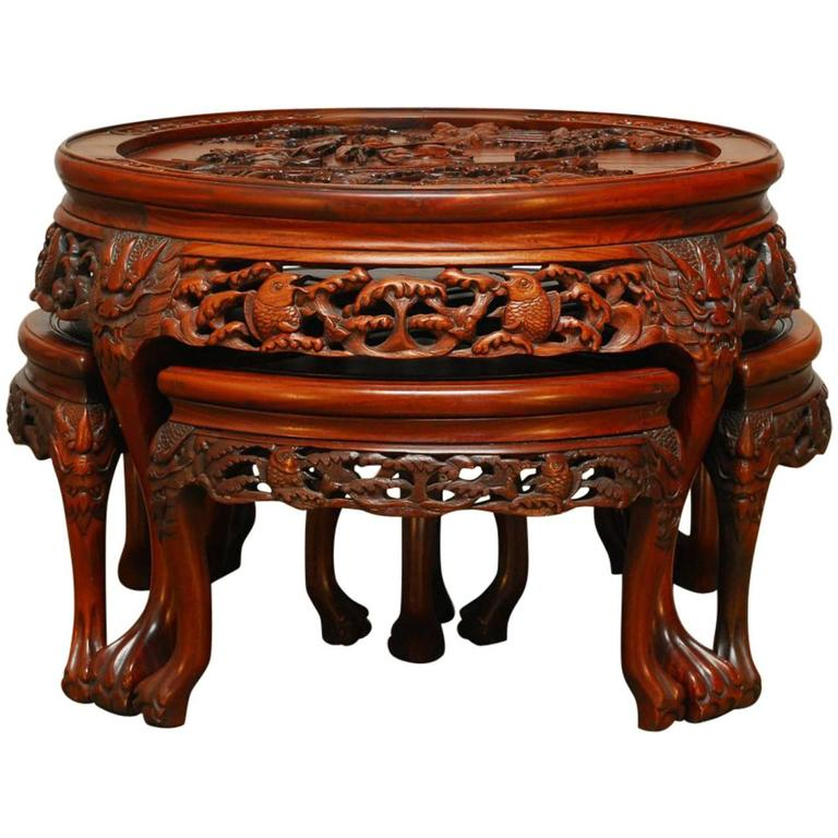 Round Chinese Carved Rosewood Tea Table With Nesting Stools For Sale
