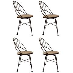 Set of Four Wrought Iron Swivel Chairs
