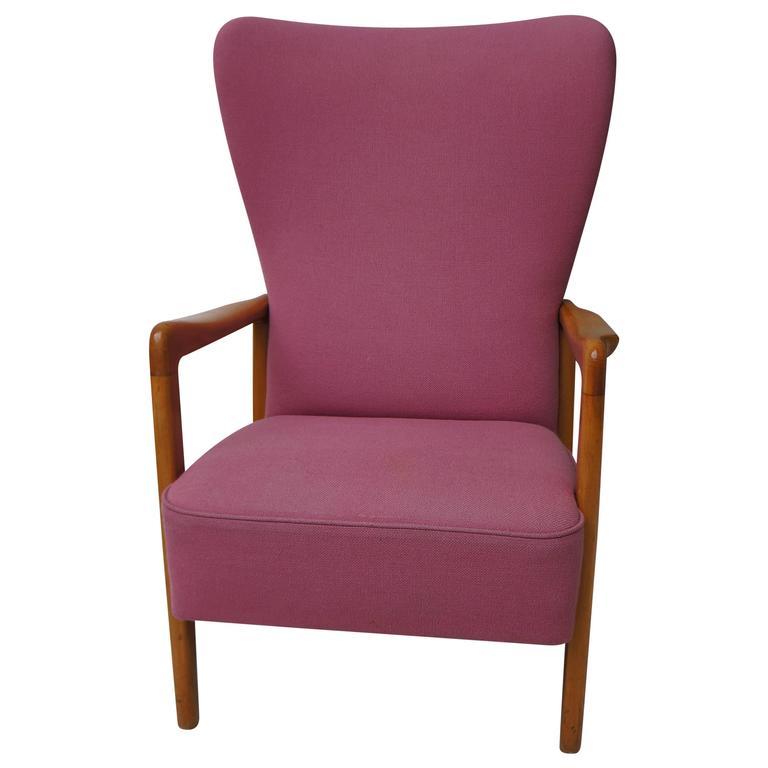 Scandinavian Danish Modern Wooden Armlegs Pink Upholstery Lounge Chair 1950s