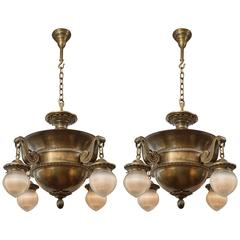 Monumental Pair of Edwardian Bronze Four-Arm Chandeliers