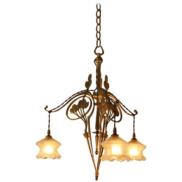 French art nouveau bronze and opalescent glass chandelier for Chandelier art nouveau