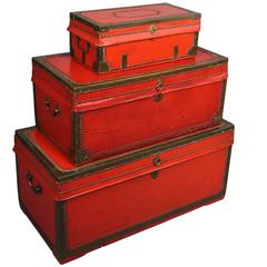 Nest of Three Chinese Export Red Lacquered Leather Trunks