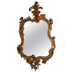 Heavily Carved Giltwood Baroque Style Mirror